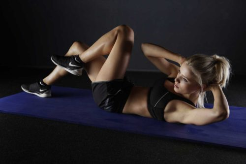 Woman working out in Nike trainers