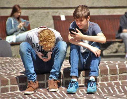 Kids playing Pokemon Go game